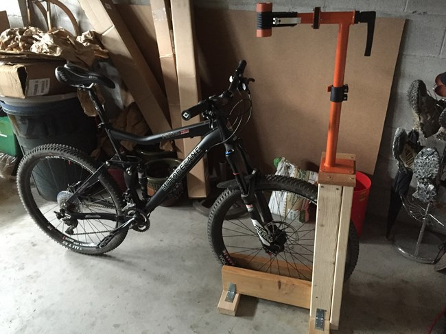 DIY Bike Rack and Stand holding front wheel of bike